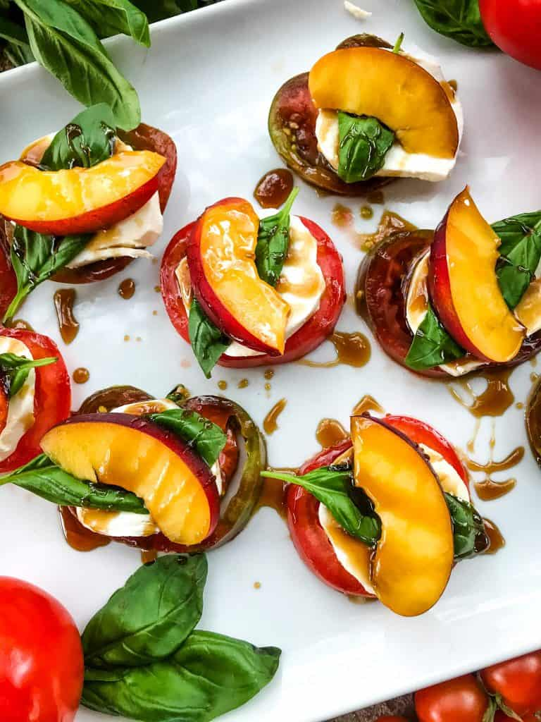 Stacks of Nectarine Tomato Caprese Salad (Peach Caprese Salad) drizzled with balsamic glaze