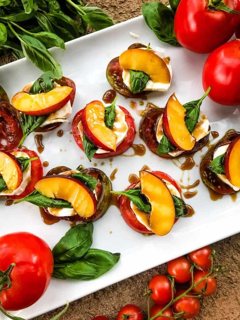 A plate of Nectarine Tomato Caprese Salad (Peach Caprese Salad) stacks