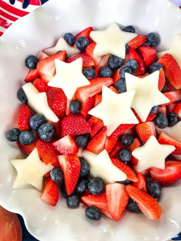 A white bowl with Patriotic Red, White, and Blue Fruit Salad