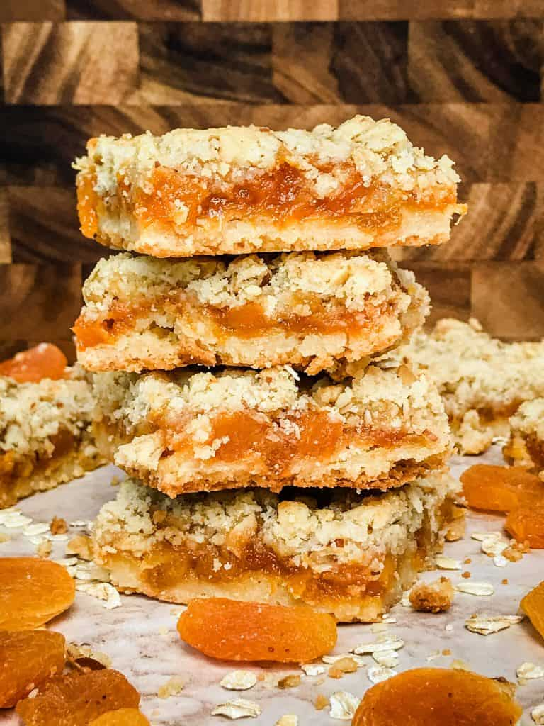 Apricot Crumble Bars in a stack surrounded by dried fruit