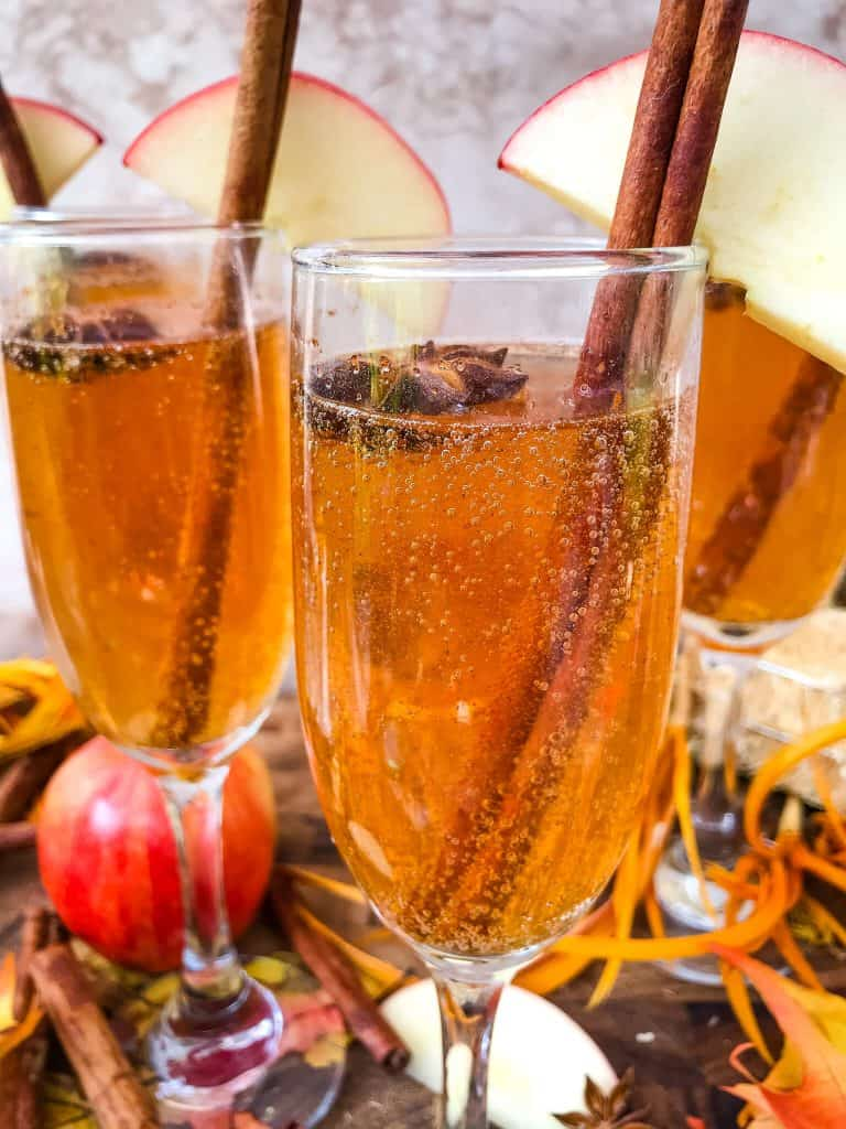 Glass of sparkling wine with a cinnamon stick