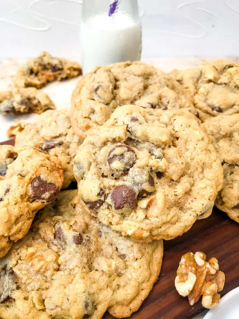 A pile of Real DoubleTree Cookies Recipe with milk behind it