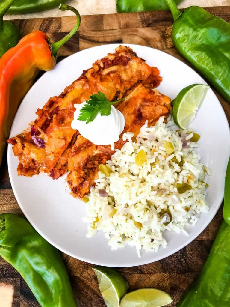 A plate with red enchiladas and Hatch Green Chile Rice