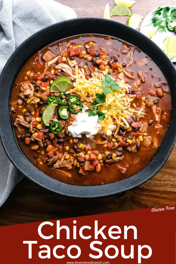 Pin image of Chicken Taco Soup in a black bowl on a wood table with title at bottom