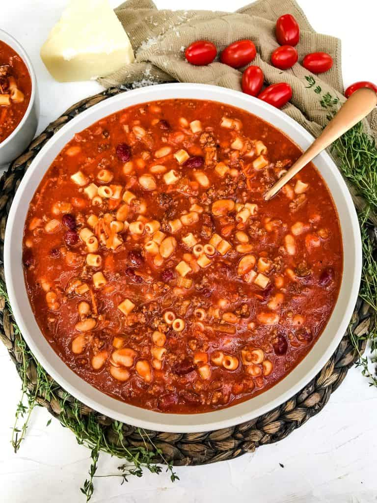 A large bowl of bean, pasta, and beef soup