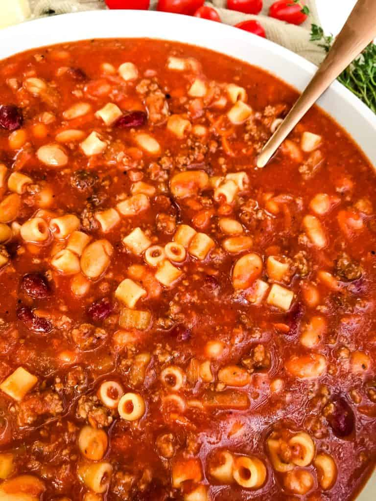 Large bowl of Copycat Olive Garden Pasta Fagioli Soup with a spoon