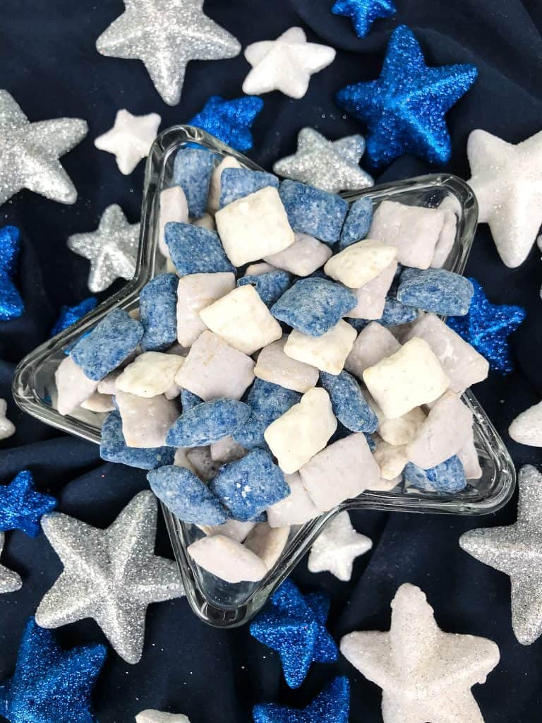 Dallas Cowboys Puppy Chow in a star dish surrounded by glitter stars