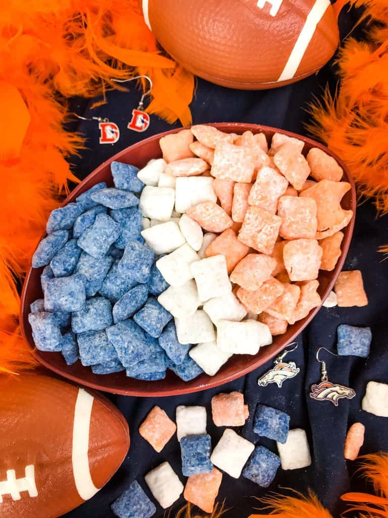 Blue, orange, and white muddy buddies separated in a football bowl