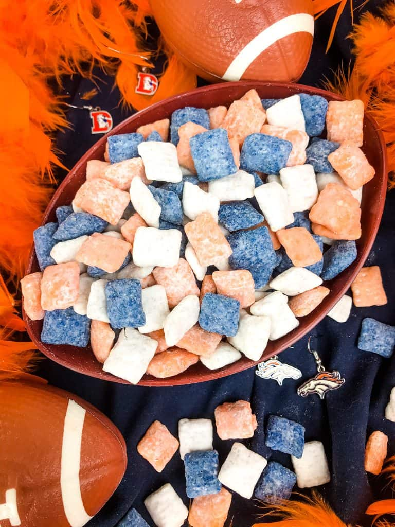 A bowl filled with Denver Broncos Puppy Chow
