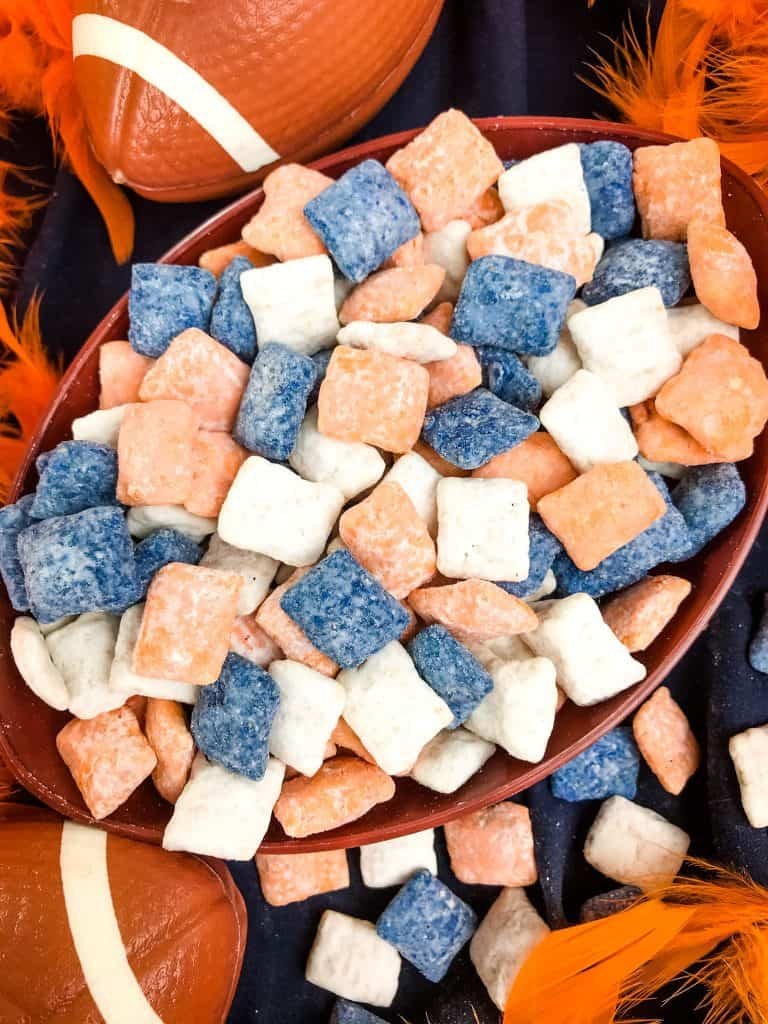 Close up of mixed Denver Broncos Puppy Chow