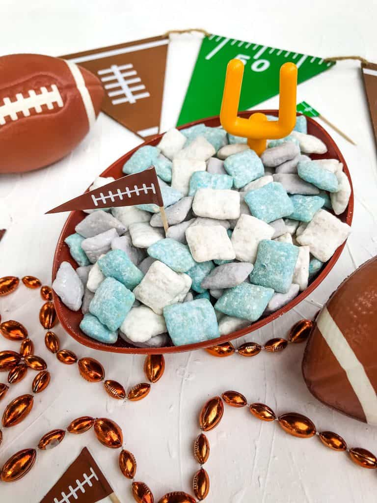 Blue, gray, and white, dessert Chex surrounded by football items