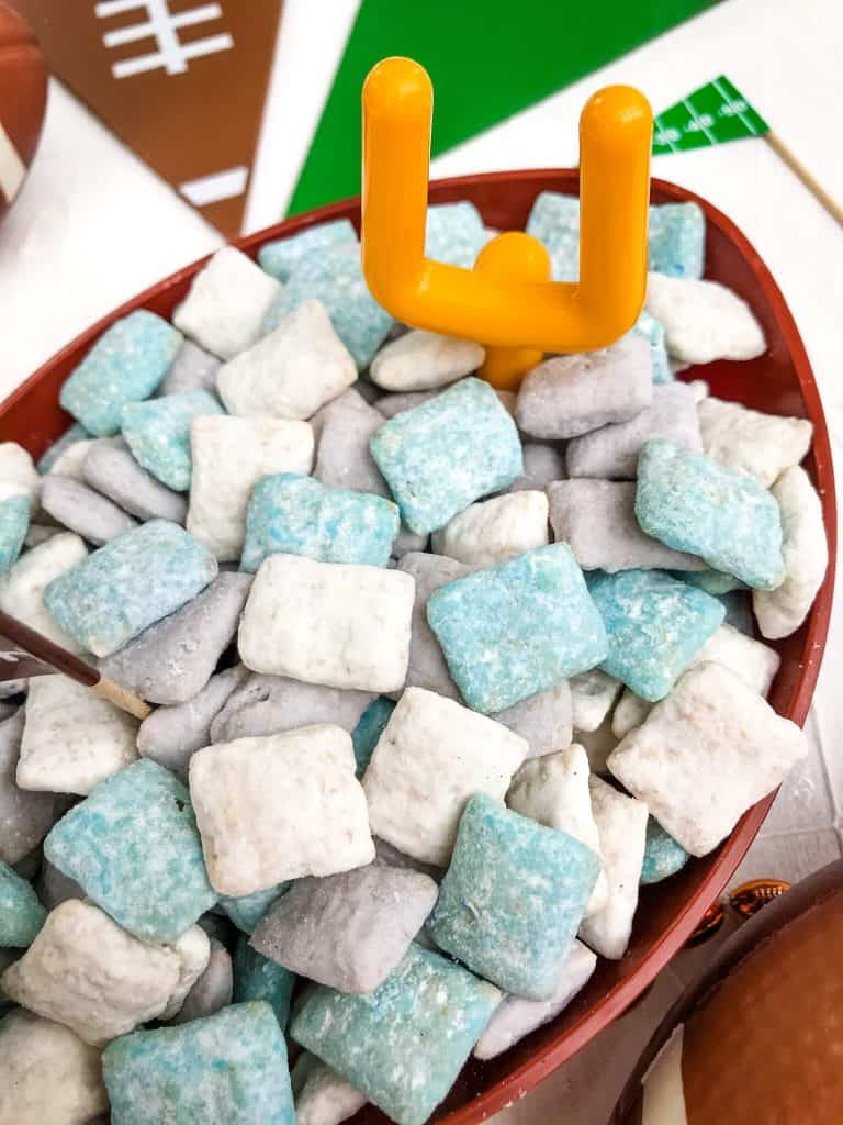 Light blue, gray, and white muddy buddies in a bowl with a small goalpost