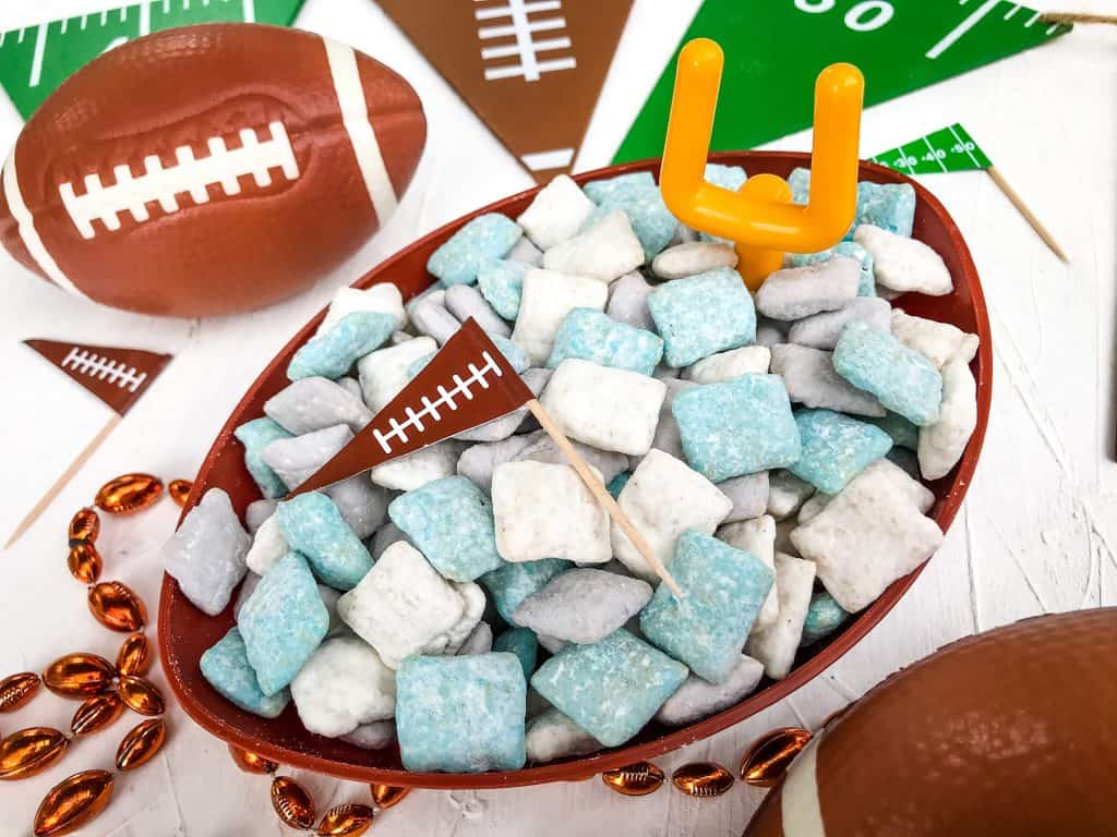Detroit Lions Puppy Chow in a football bowl surrounded by football decorations