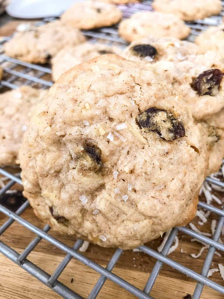 A close up of a Chewy Coconut Oatmeal Raisin Cookies with Walnuts