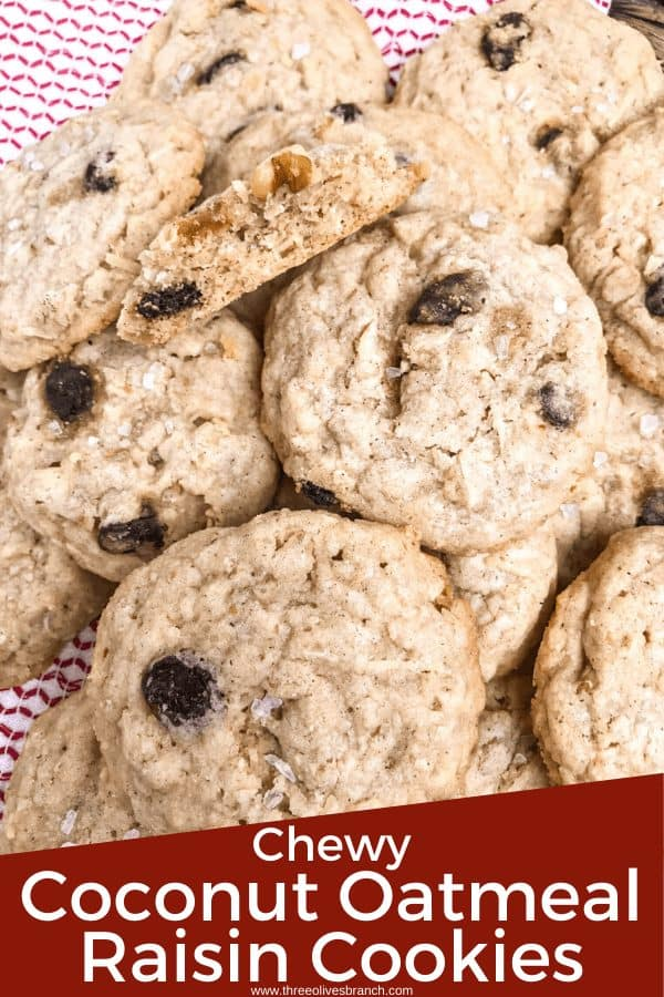 Pin image for Chewy Coconut Oatmeal Raisin Cookies with Walnuts in a pile on a red and white towel with title at bottom