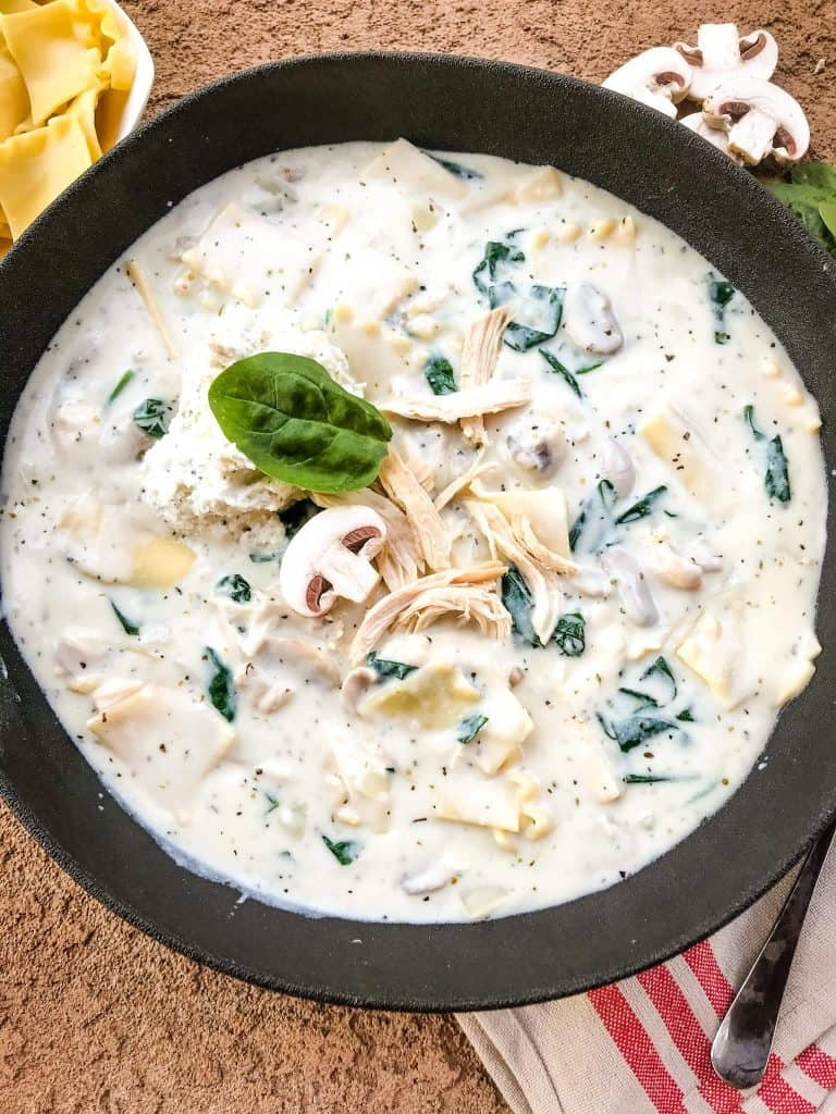 Bowl of White Chicken Lasagna Soup with chicken on top