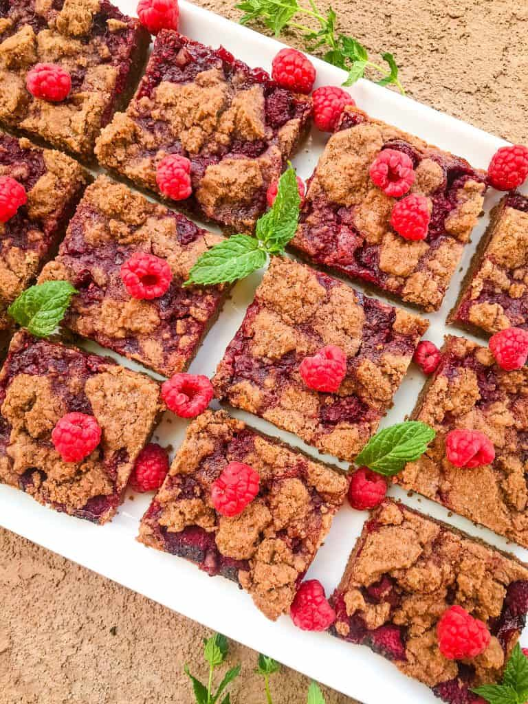 The cookie bars on a white tray with mint