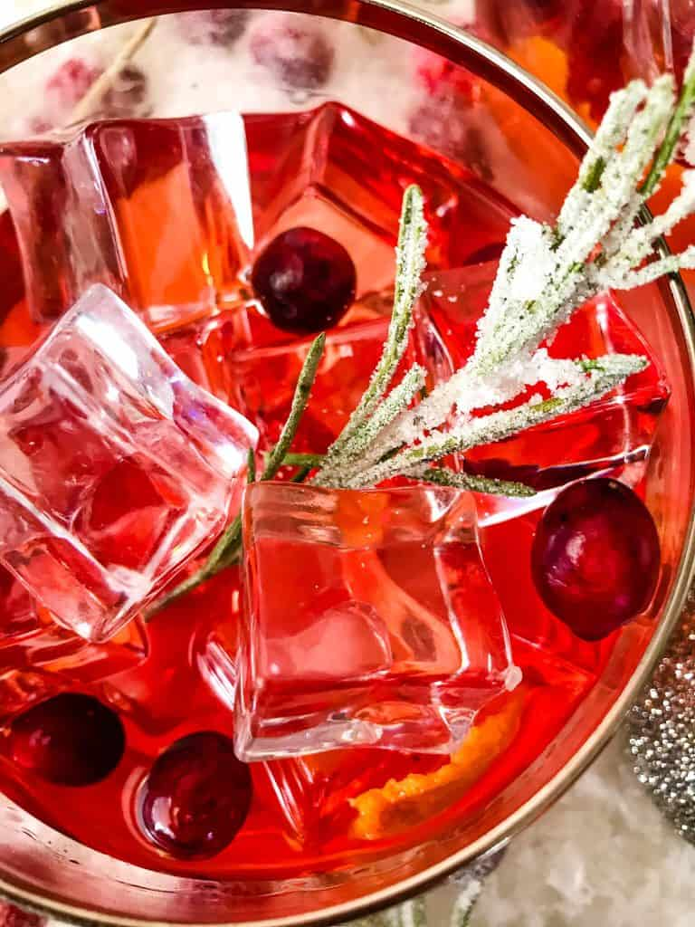 Close up of Cranberry Old Fashioned Cocktail from top