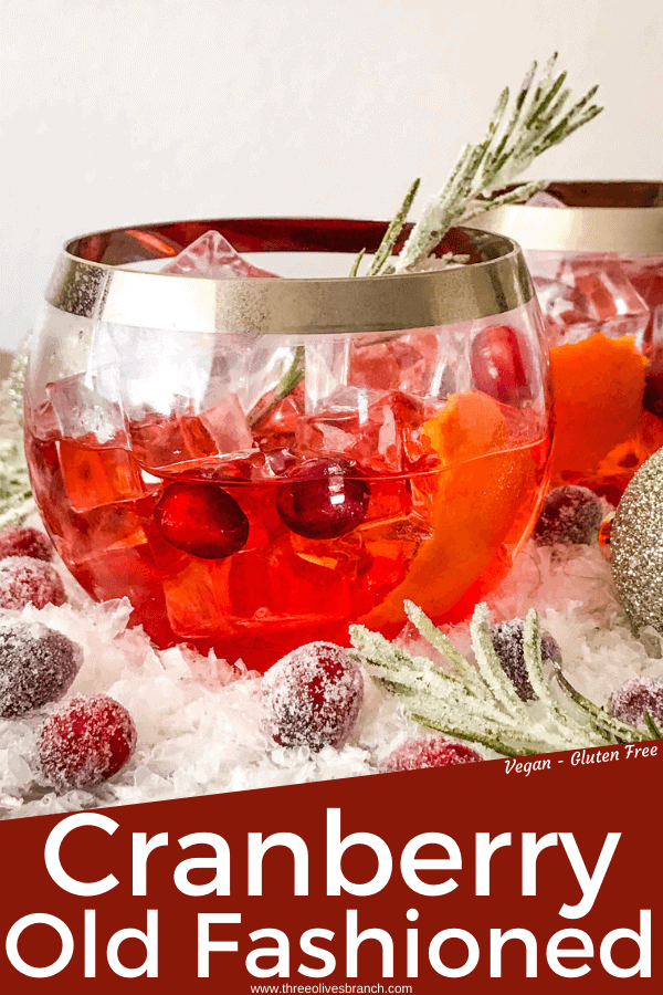 Pin image for Cranberry Old Fashioned Cocktail with red cocktail in round glass with silver rim and title at bottom
