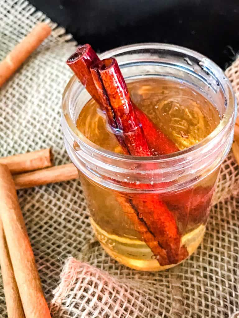 Cinnamon Simple Syrup in a glass jar with cinnamon sticks in it