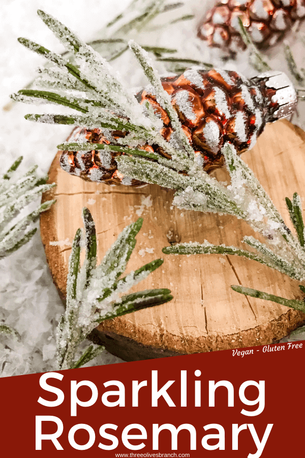 Pin image for Sparkling Rosemary (Sugared Rosemary) on a slice of wood with title at bottom
