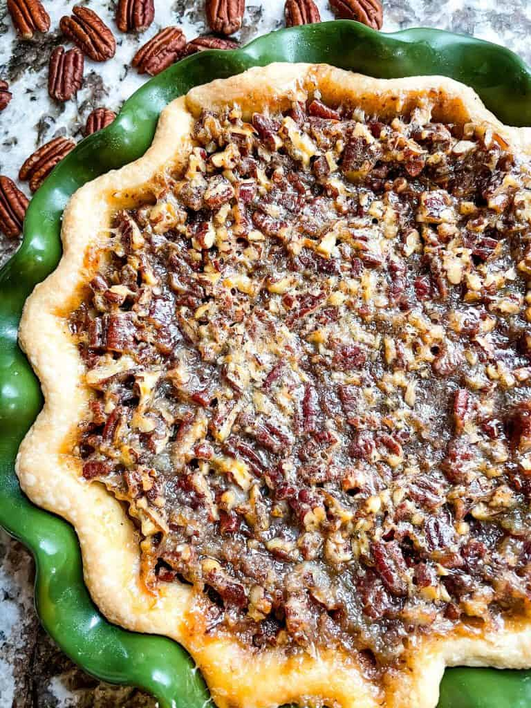 Close up top view of a cooked pecan pie