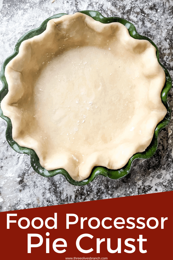 Pin image for Easy Pie Crust (Food Processor) of a crust in a green dish with title at bottom
