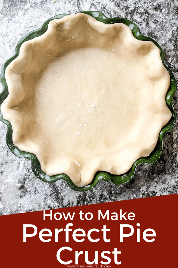 Pin image for Perfect Pie Crust Tips of dough in a green fluted pie dish with title at bottom
