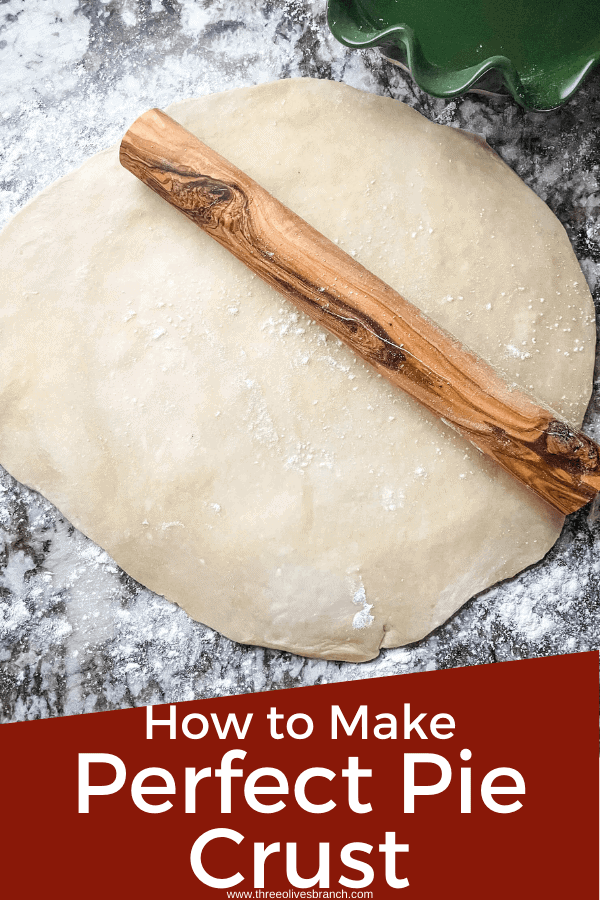 Pin image for Perfect Pie Crust Tips of a rolling pin on a round of dough with title at bottom
