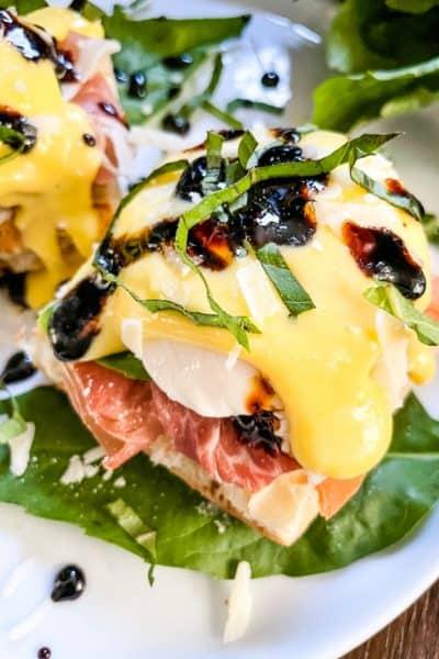 A stack of Italian Prosciutto Eggs Benedict