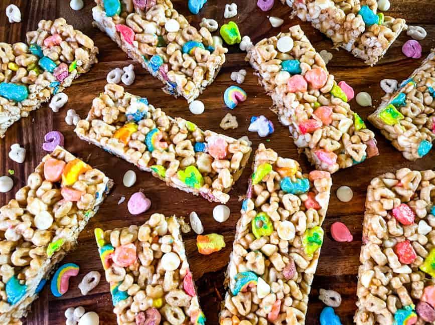 Lucky Charms Cereal Bars scattered on a wood surface