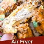 Pin image for Lemon Pepper Chicken Wings Air Fryer recipe of a hand holding a bitten wing with title at bottom
