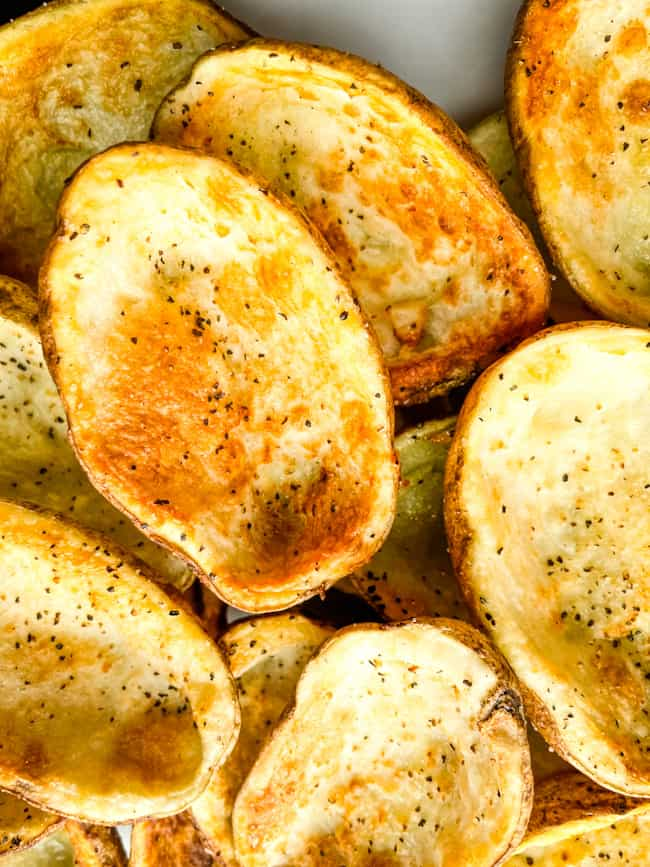 A pile of empty Air Fryer Potato Skins shells