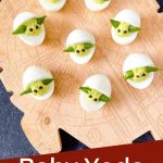 Pin image for Baby Yoda Deviled Eggs on a cutting board with title at bottom