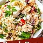 Pin image for Greek Orzo Salad in a bowl with a spoon digging into it