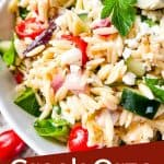 Pin image close up of Greek Orzo Salad with title at bottom