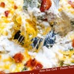 Pin image for Keto Chicken Bacon Ranch Casserole with spoon scooping casserole out of the dish with title at bottom