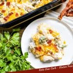 Pin image of Keto Chicken Bacon Ranch Casserole on a plate next to the serving dish with title at bottom