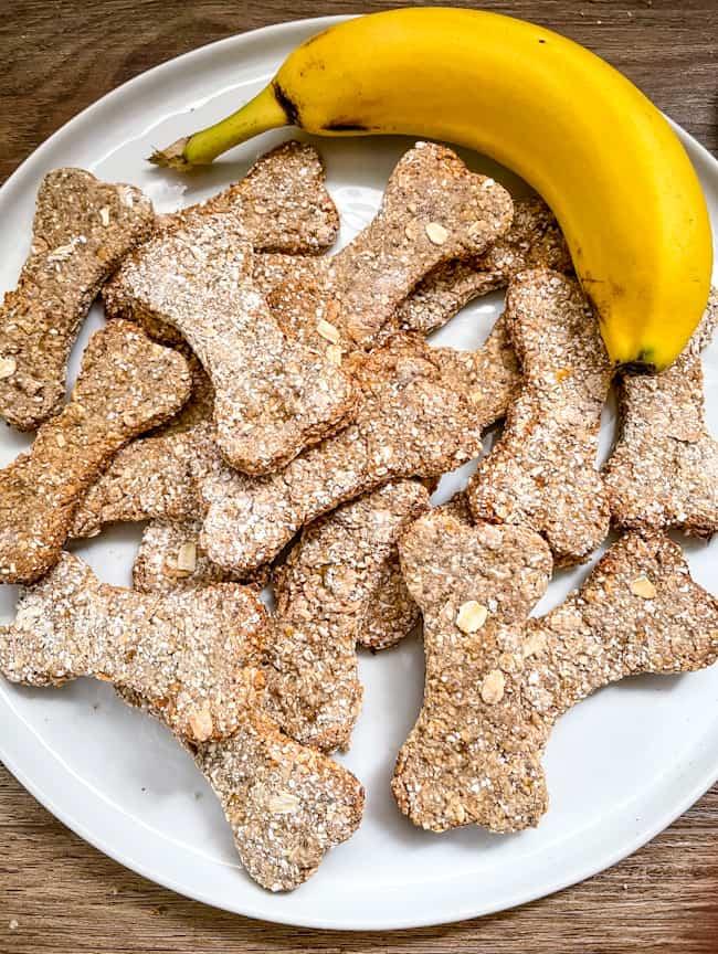 A white plate stacked with Banana Dog Treats and a banana