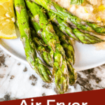 Pin image for Air Fryer Asparagus on a plate with title at bottom