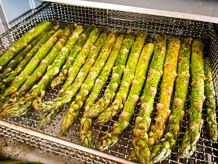 Asparagus stalks in the basket just after being cooked