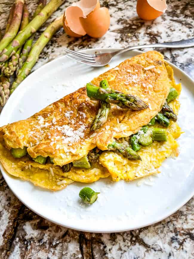 Asparagus Omelette on a white round plate