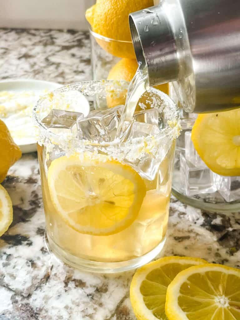 A shaker pouring a Lemon Margarita into a glass