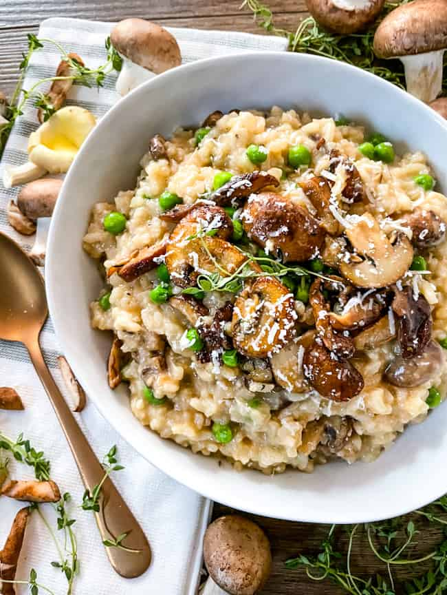Mushroom Pea Risotto in a bowl on top of a towel
