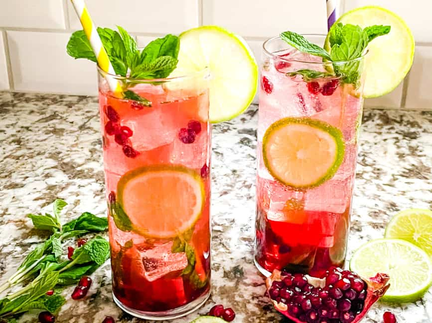 Two rum cocktails with lots of lime and fruit