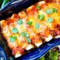 A blue dish filled with Southwest Ground Turkey Enchiladas
