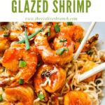 Pin image for Chipotle Orange Glazed Shrimp on noodles with chopsticks in a bowl