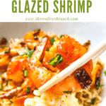 Pin image of chopsticks holding a Chipotle Orange Glazed Shrimp over a bowl
