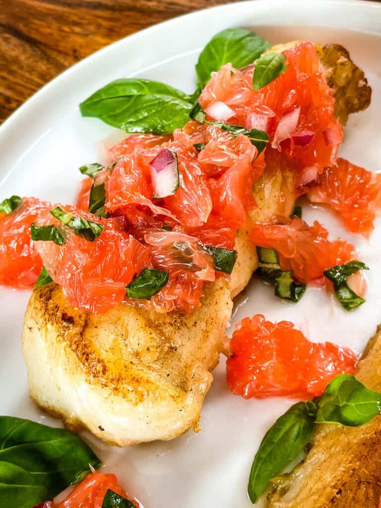 Close up of a fish steak with the citrus topping