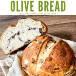 Pin image of a loaf of Sourdough Olive Bread with some slices and title at top